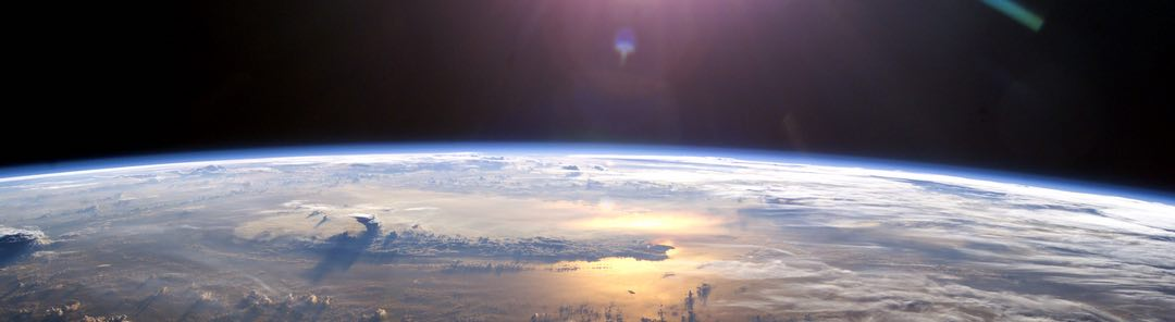 Photo of the Earth taken from space with the sun rising over the horizon