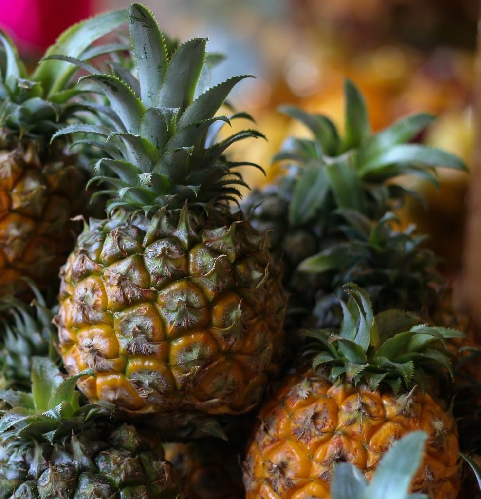 Photo of a group of pineapples in a pile